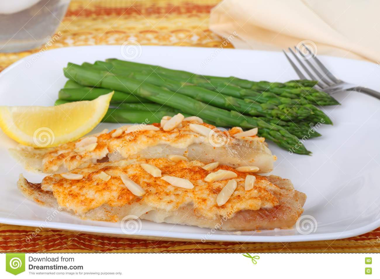 Fish fillets and asparagus royalty free stock images for Crab topping for fish