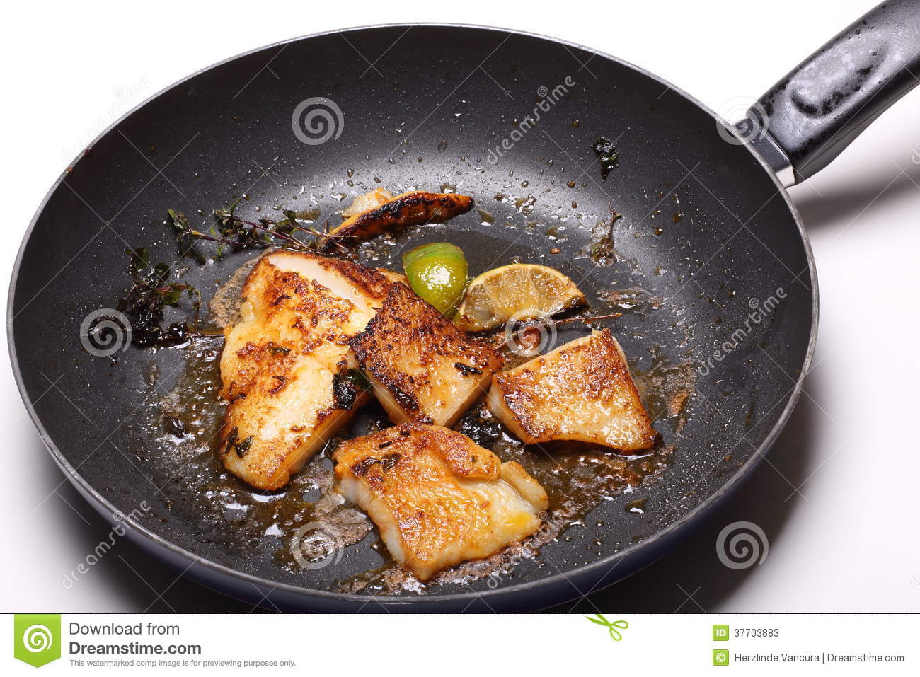 Fish fillets in frying pan stock photos image 37703883 for Pan fried fish fillet recipes