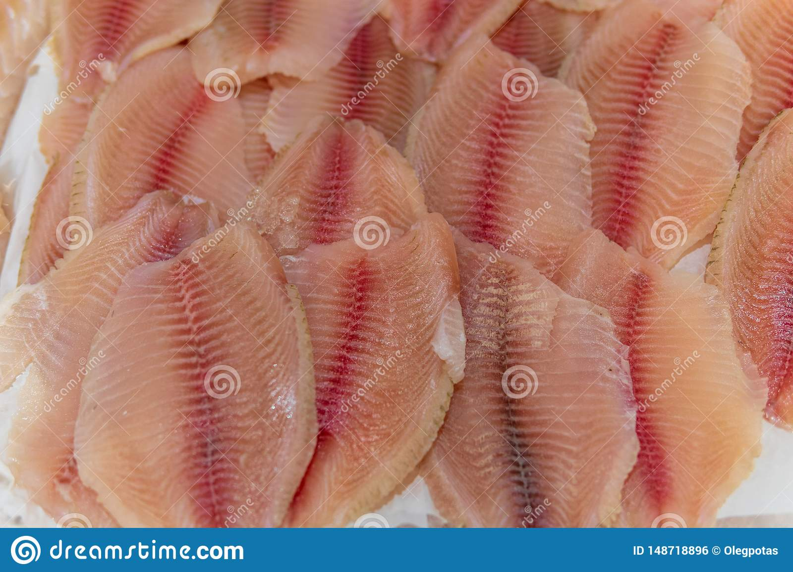Fish, fish steaks and fish fillets lie on the ice in the supermarket