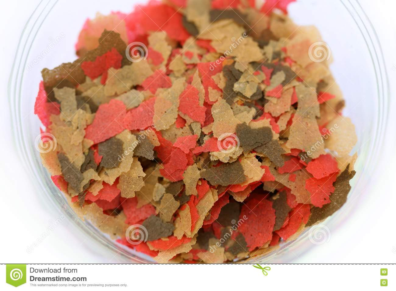 Fish food flakes in glass dish stock photos image 14193783 for Fish food flakes