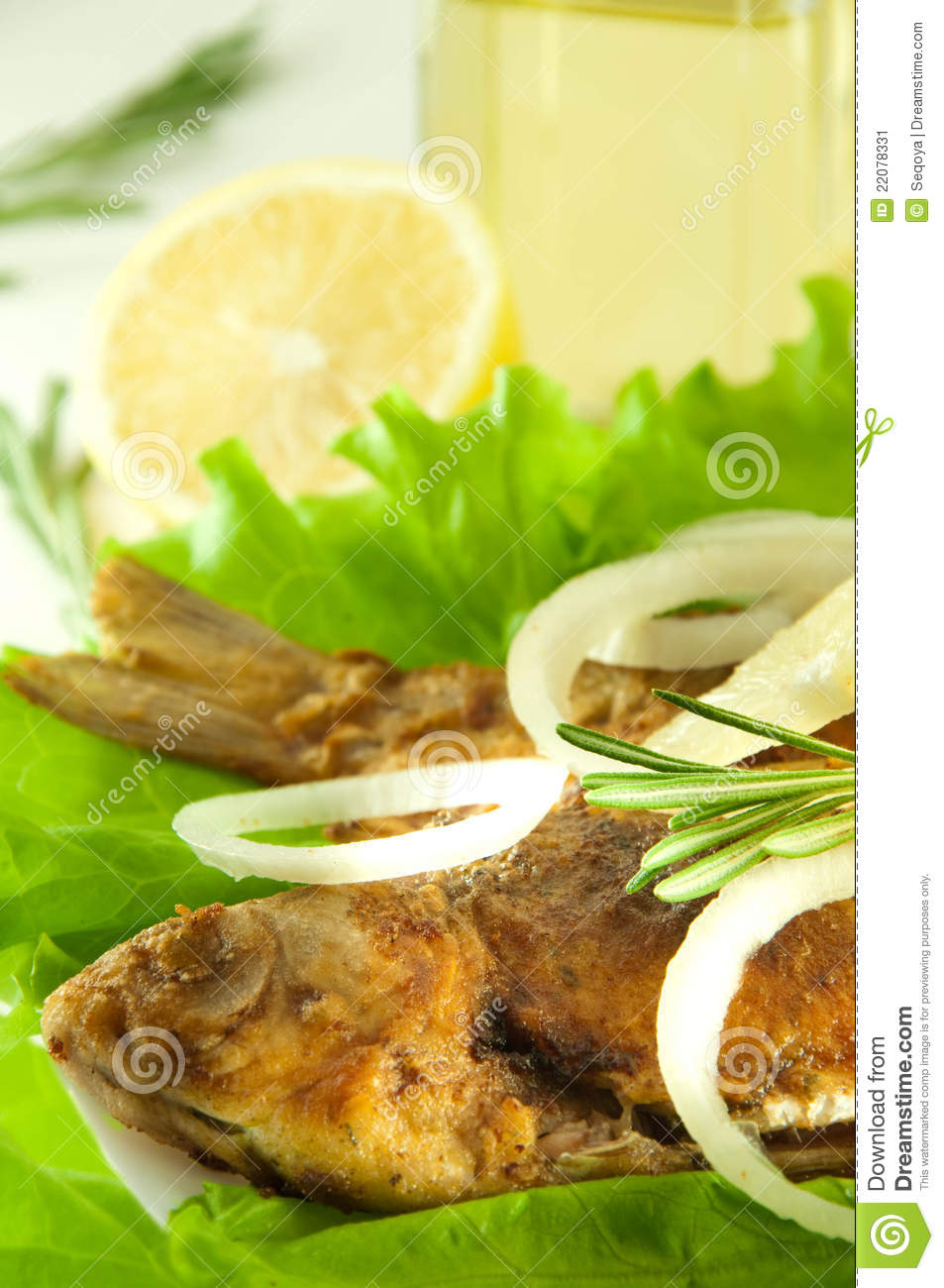 Fish fried a crucian with a lemon rosemary stock image for Frying fish in olive oil