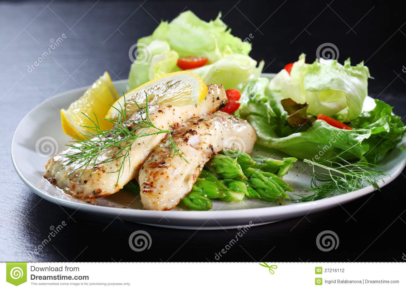 Fish on green asparagus with salad stock photography for Fish and asparagus