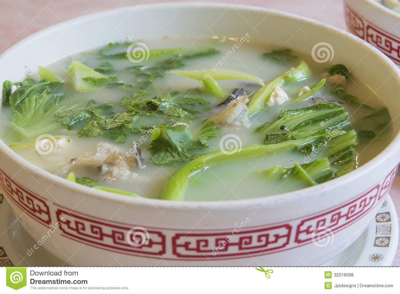 Fish head soup with chinese vegetable closeup royalty free for Fish head soup recipe