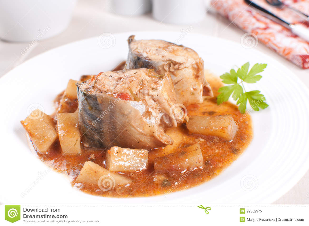 Fish mackerel with tomato and potato stew royalty free for Fish stew with potatoes