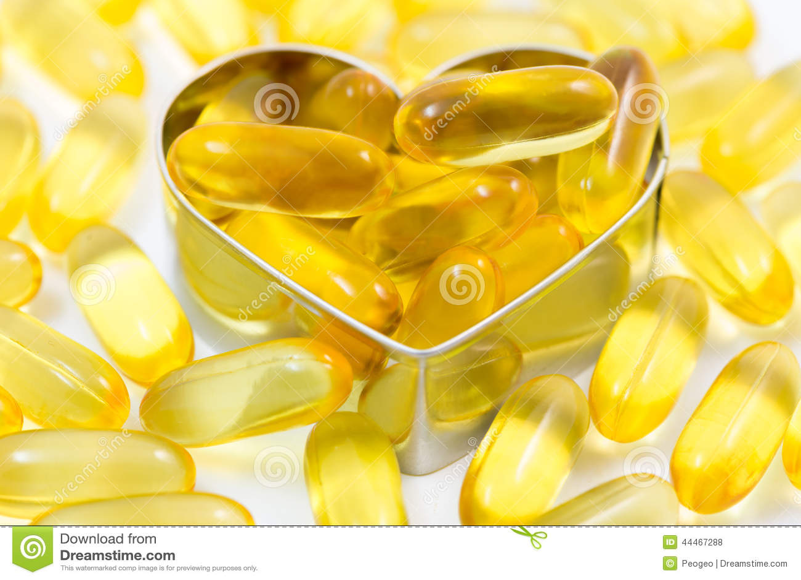 Fish oil pills on heart shape box