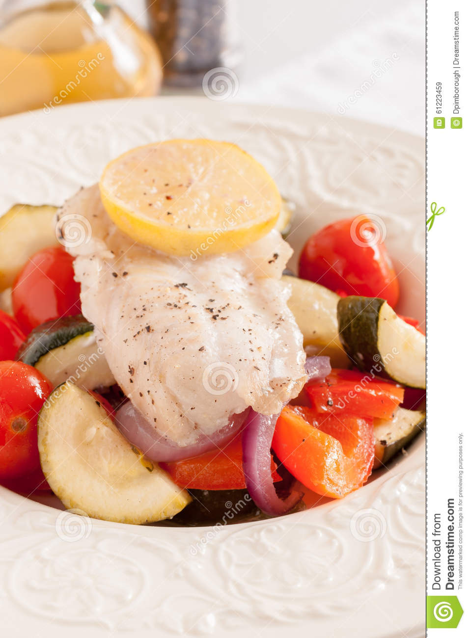 Fish Provencal a French dish with roasted vegetables and white fish ...