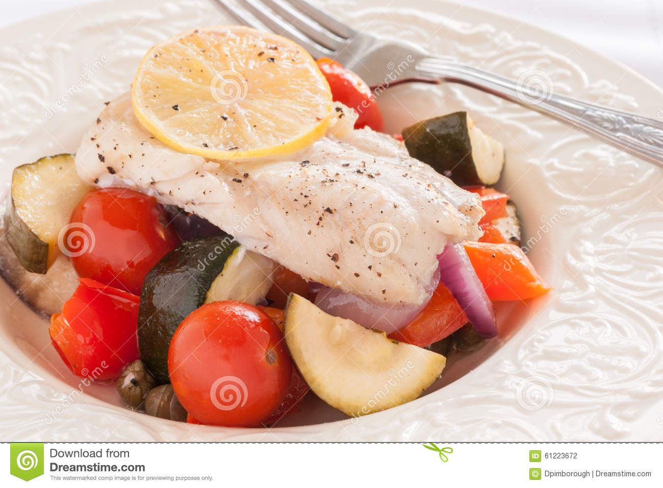 Fish Provencal a French seafood dish of roasted vegetables and white ...
