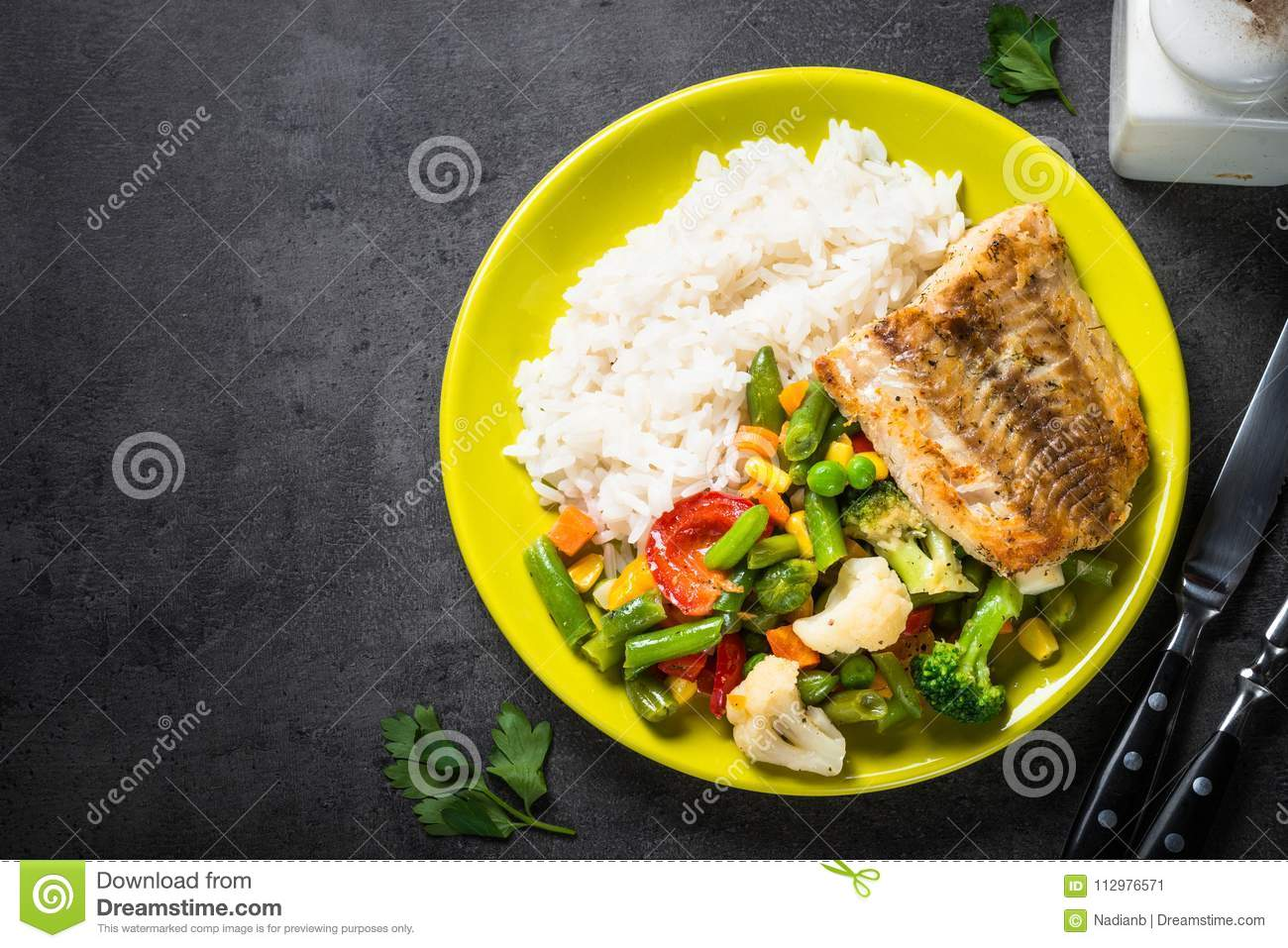 Sea fish, rise and vegetables.