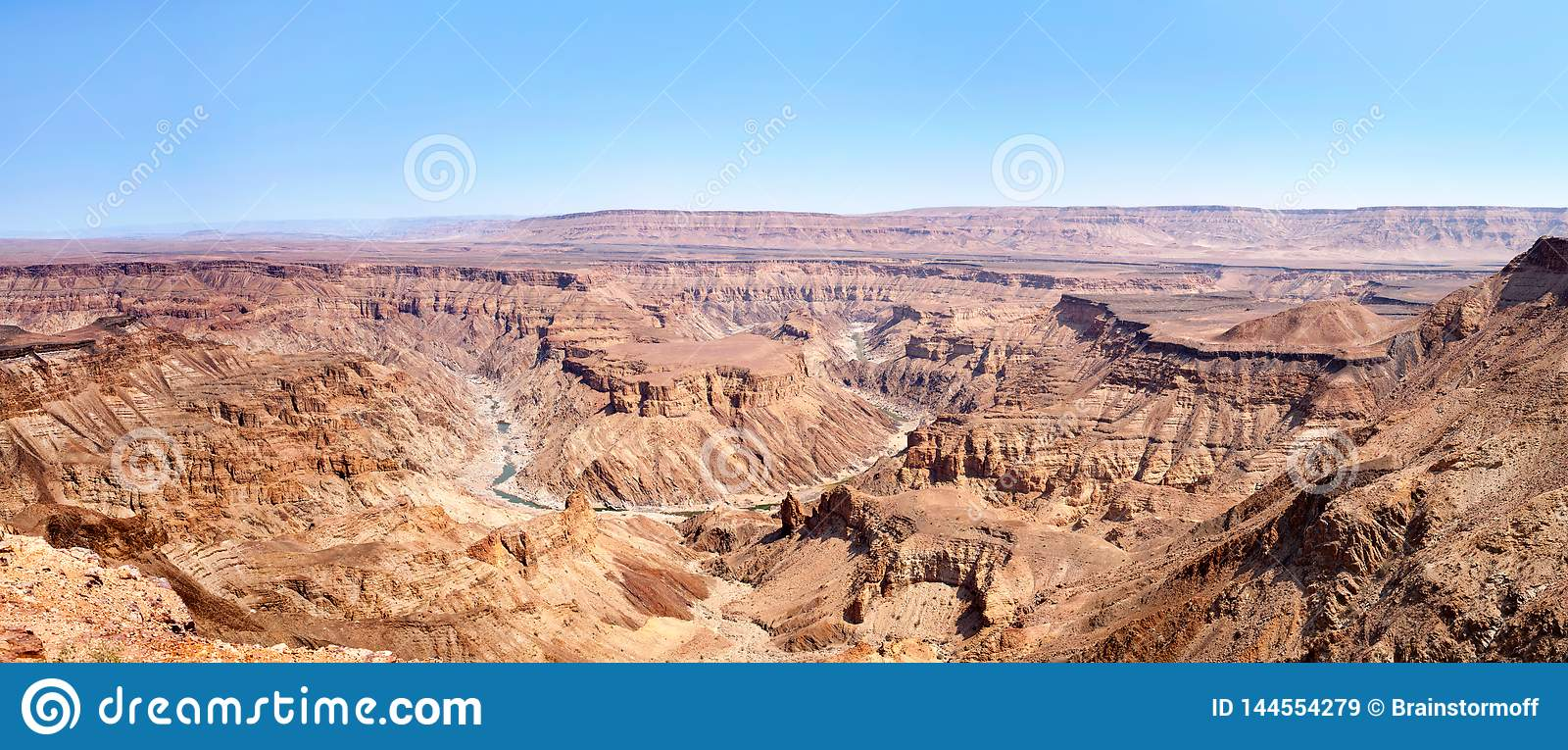 Fish River Canyon during the dry season top view, beautiful scenic mountain landscape panorama in Southern Africa, Namibia