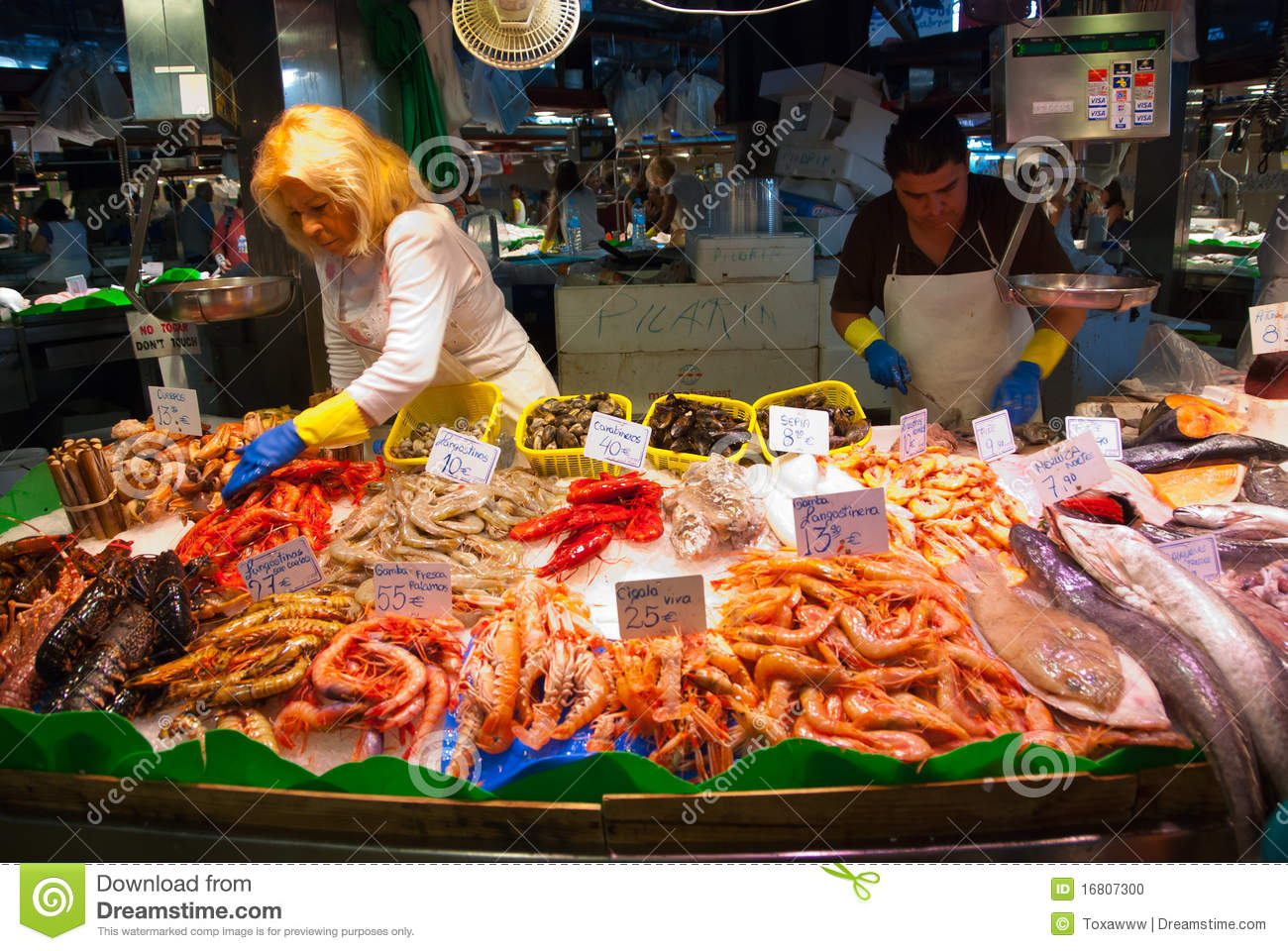 BARCELONA - AUGUST 24: Unidentified persons works in a fish shop in La ...
