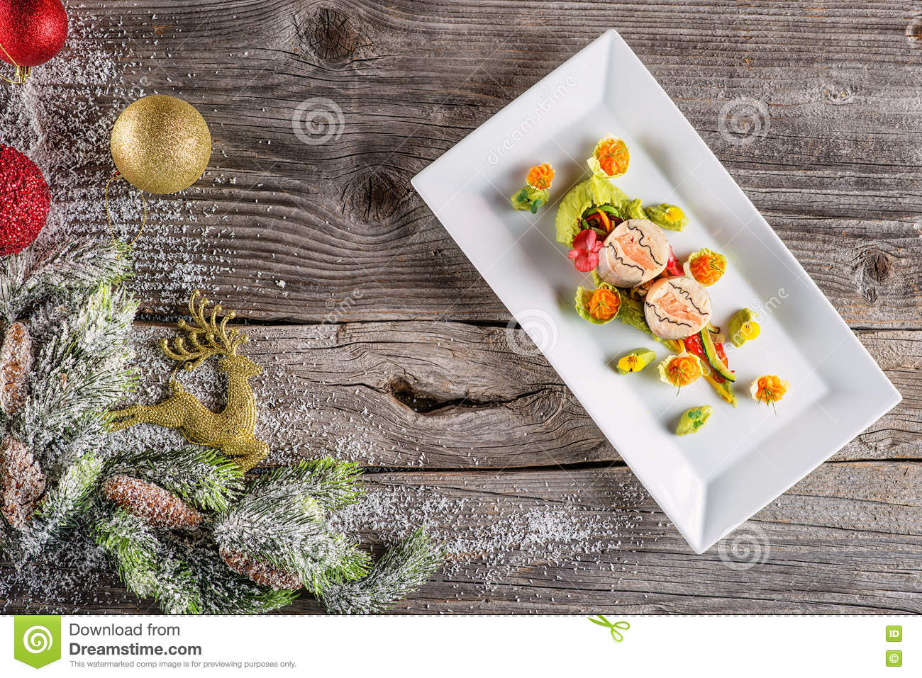 Fish starter food on white plate with christmas decoration for Christmas fish starters