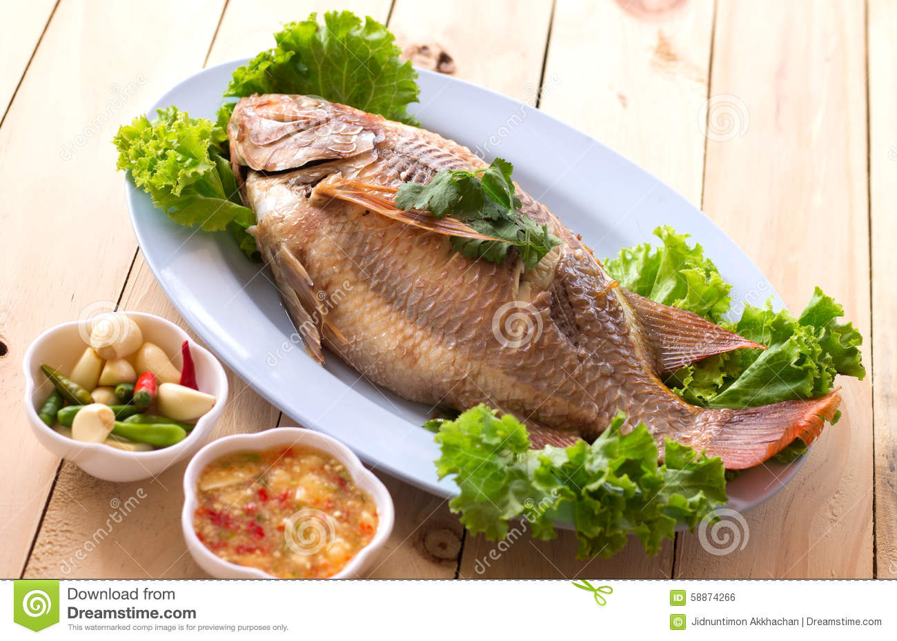 Download Fish.steamed Fish Chinese Style On Wooden Stock Photo - Image of cook, fillet: 58874266