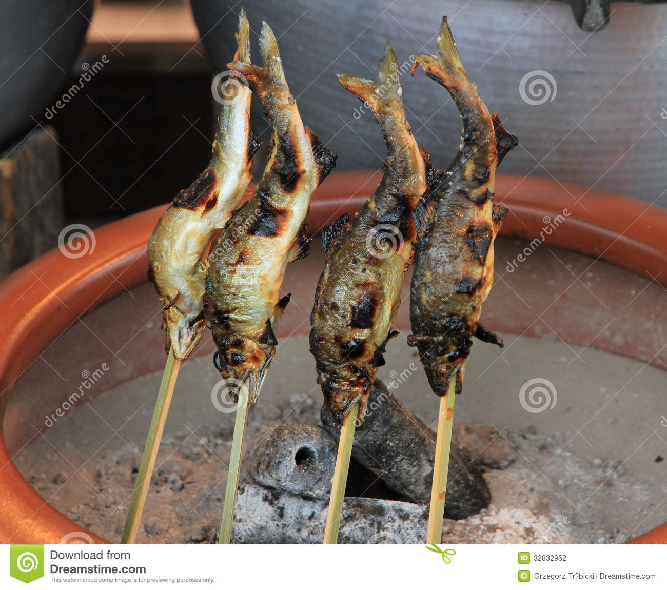 Fish on stick japanese barbecue fish stock photography for Take me fishing org