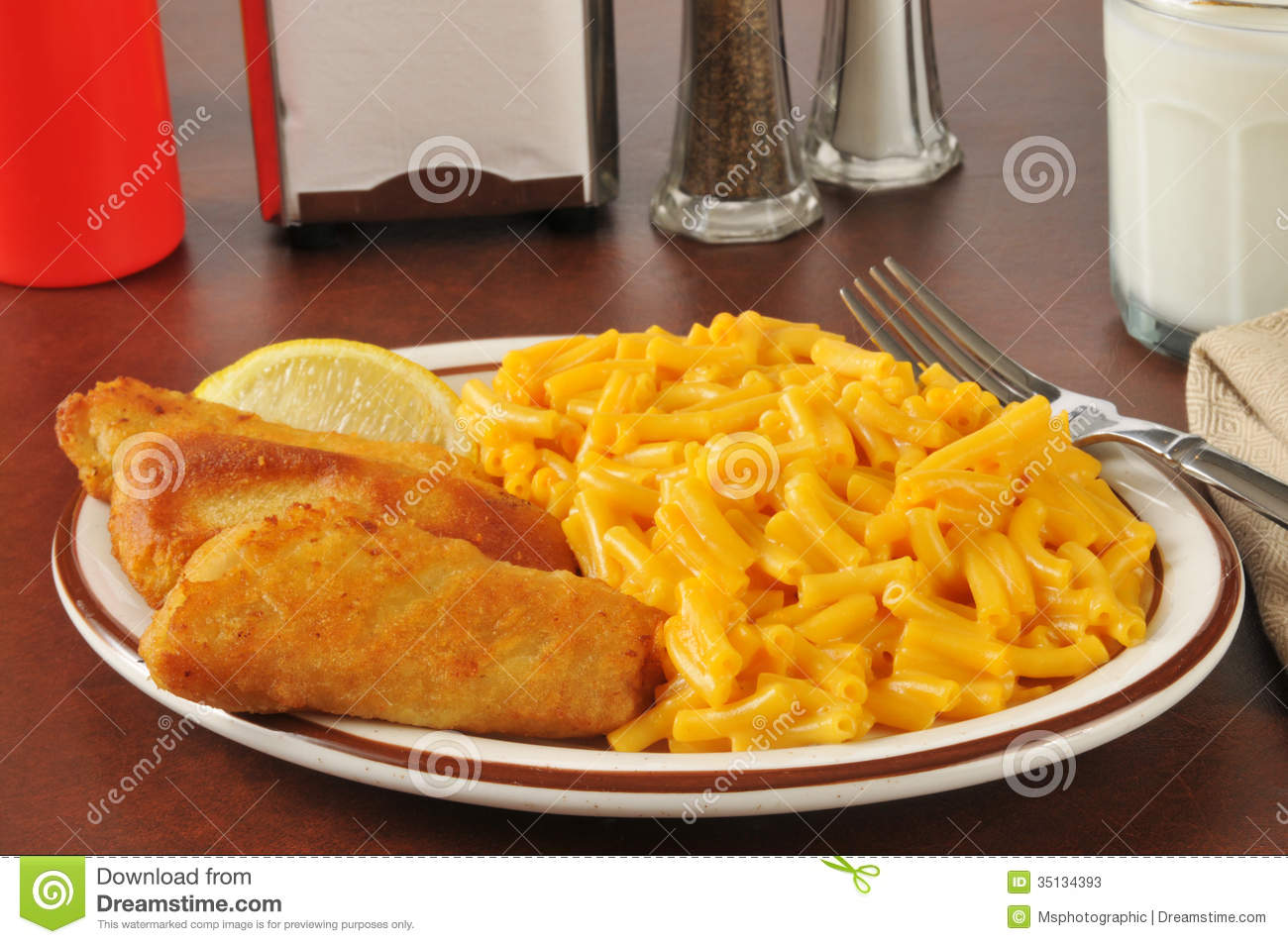 Fish sticks with macaroni and cheese stock photos image for Fish and cheese