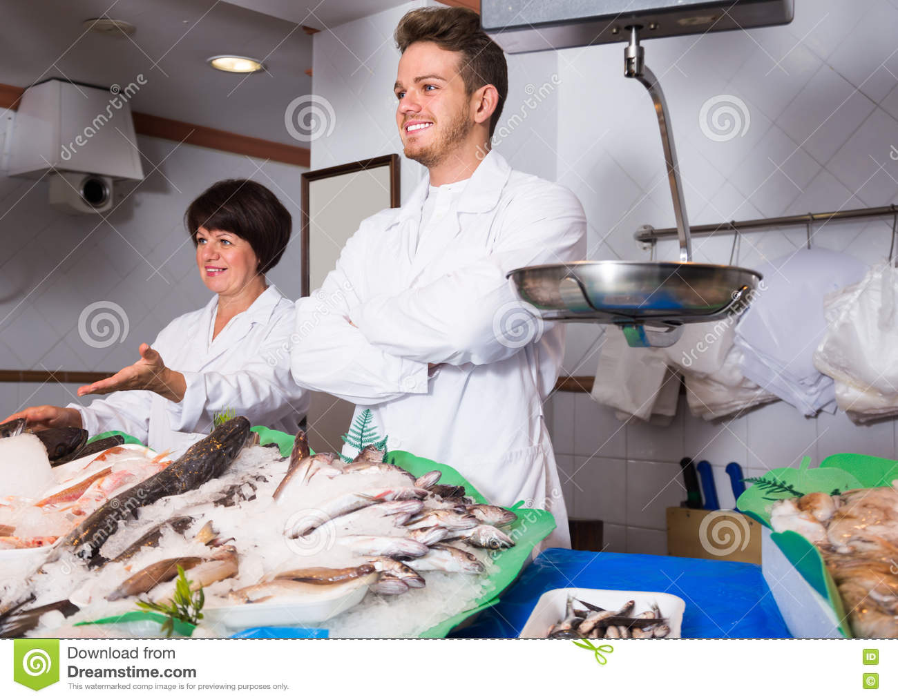 Fish store with two glad sellers