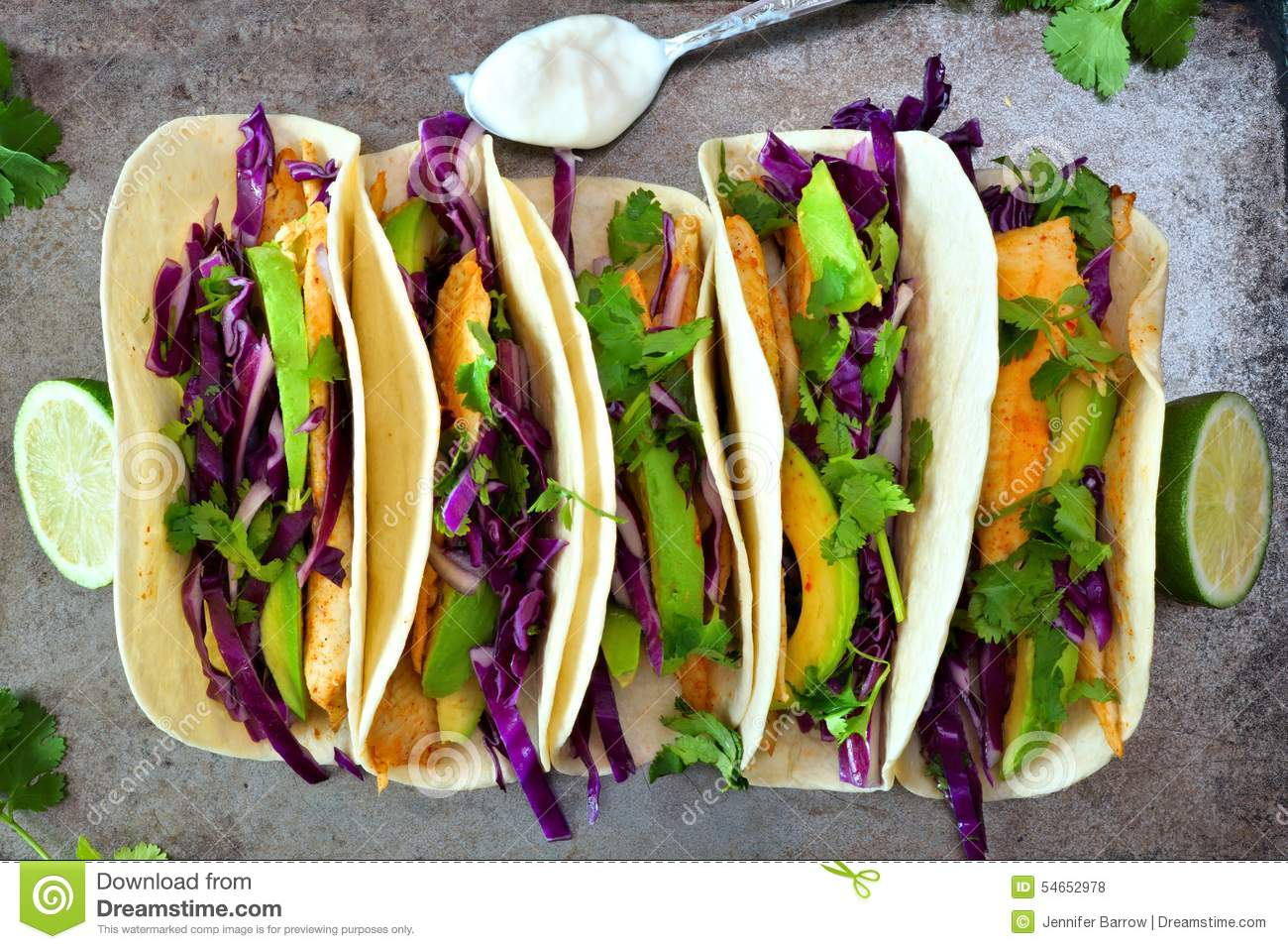 Fish tacos with red cabbage lime slaw on rustic tray stock for Fish taco red cabbage slaw