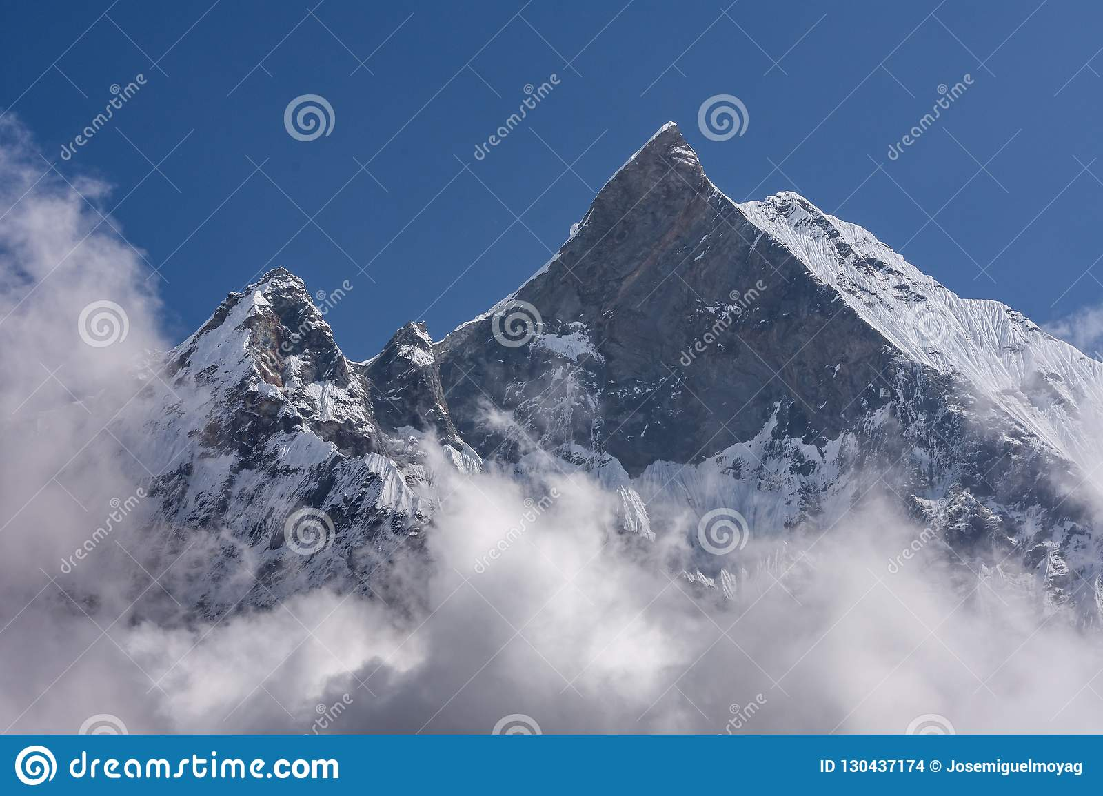 Fish Tail Summit also Machapuchare surrounded by rising clouds