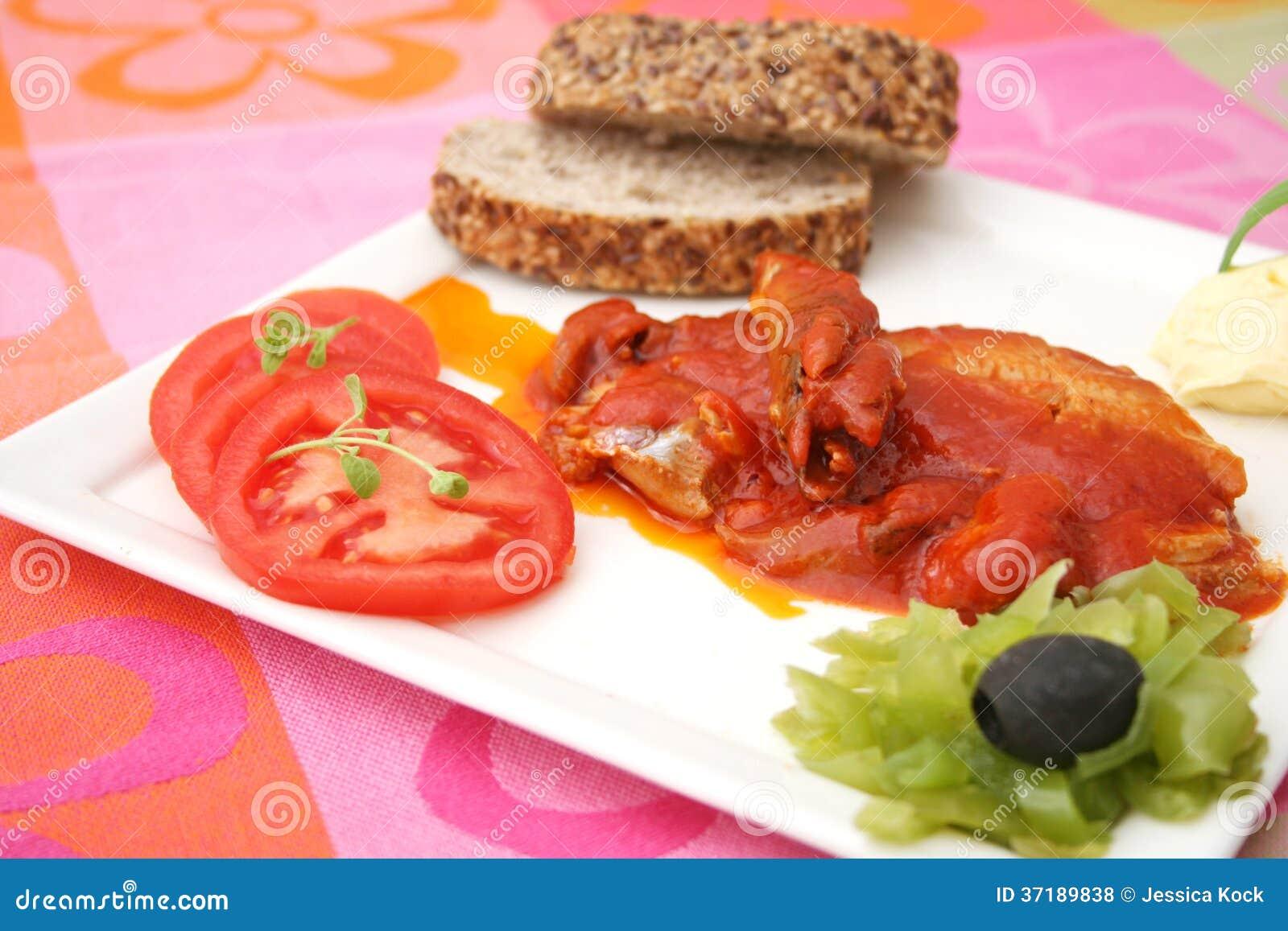 Fish in tomato sauce royalty free stock photos image for Fish in tomato sauce