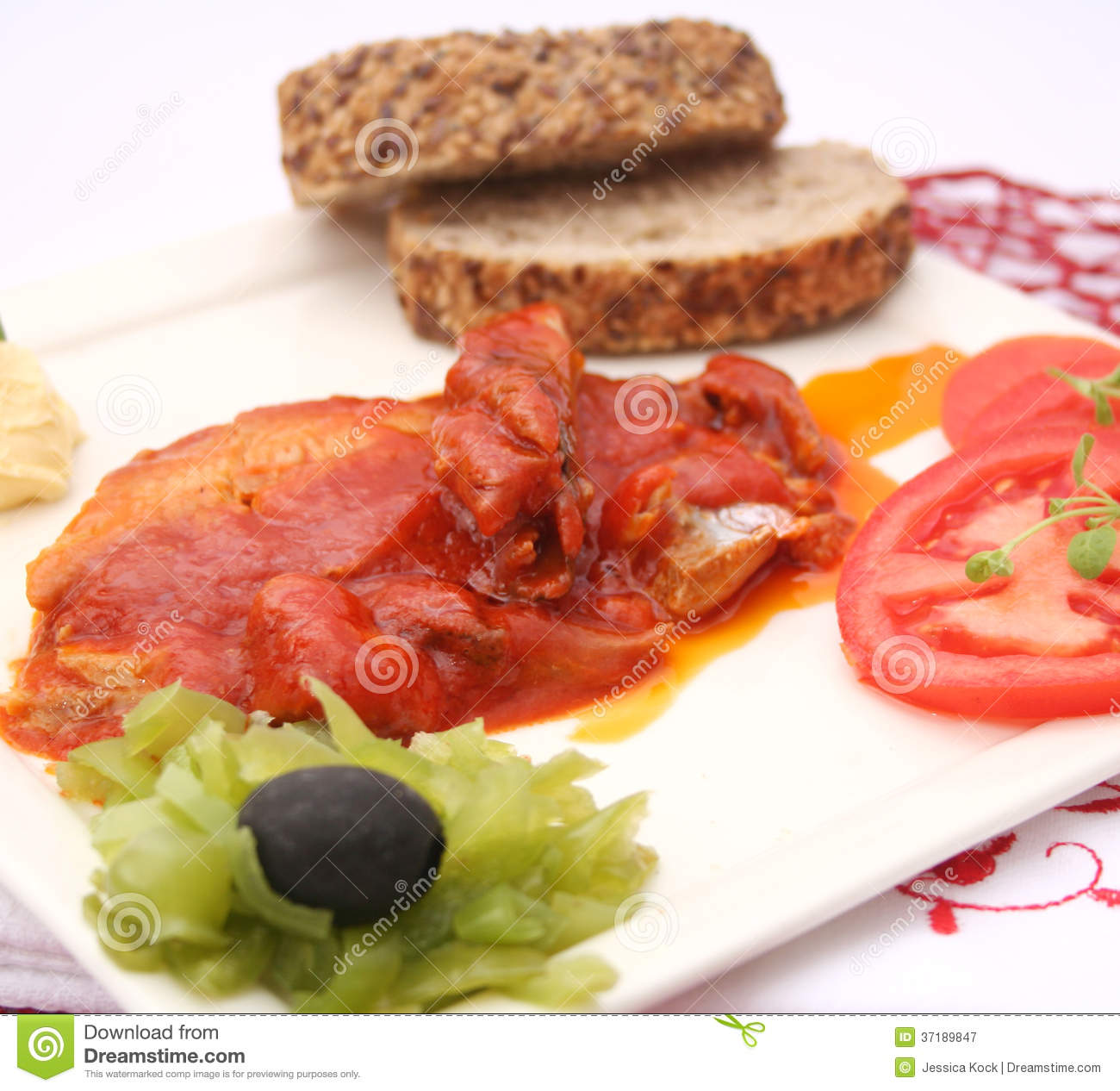 Fish in tomato sauce with tomato.