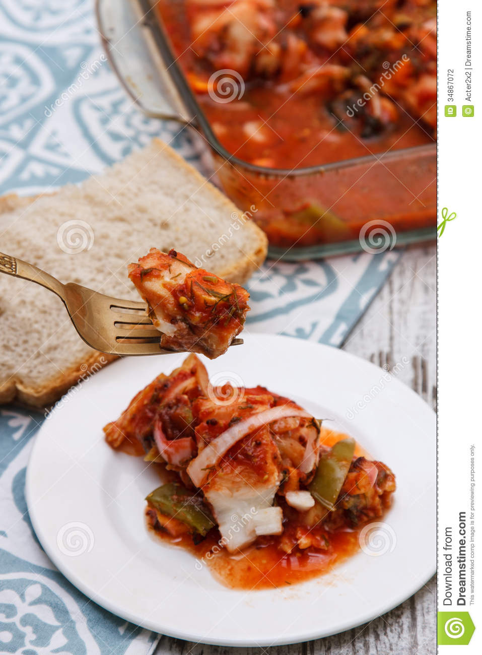 Fish in tomato sauce stock photography image 34867072 for Fish in tomato sauce