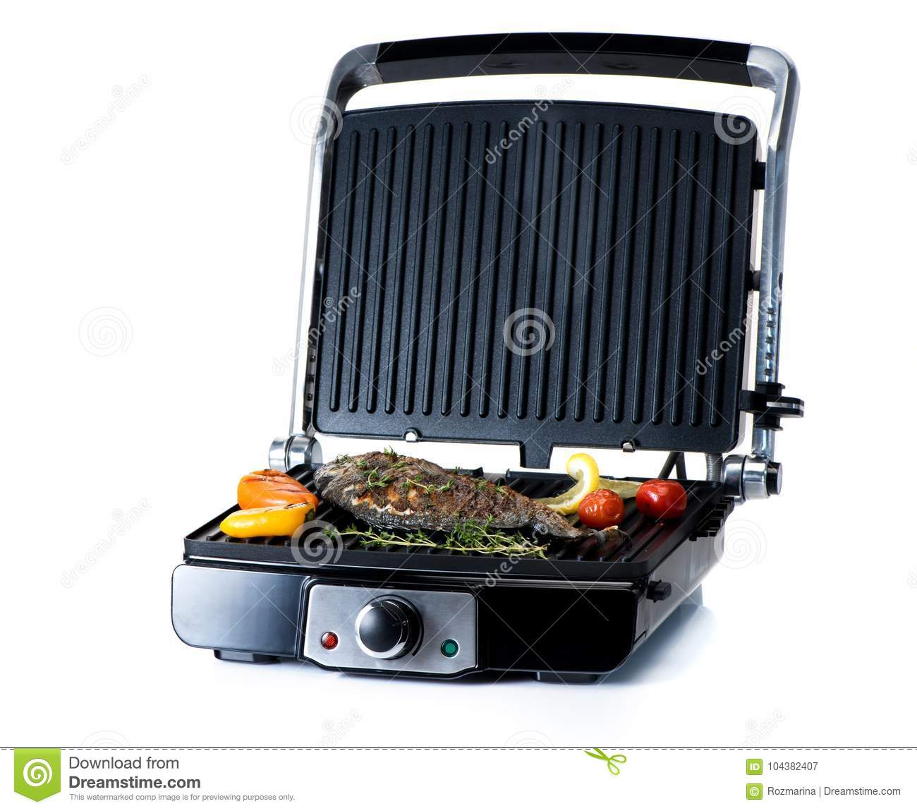 Fish and vegetables on an electric grill