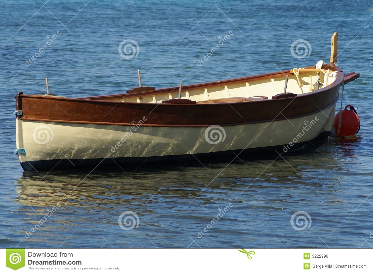 traditional boat anchored in Mediterranean sea (French Riviera).