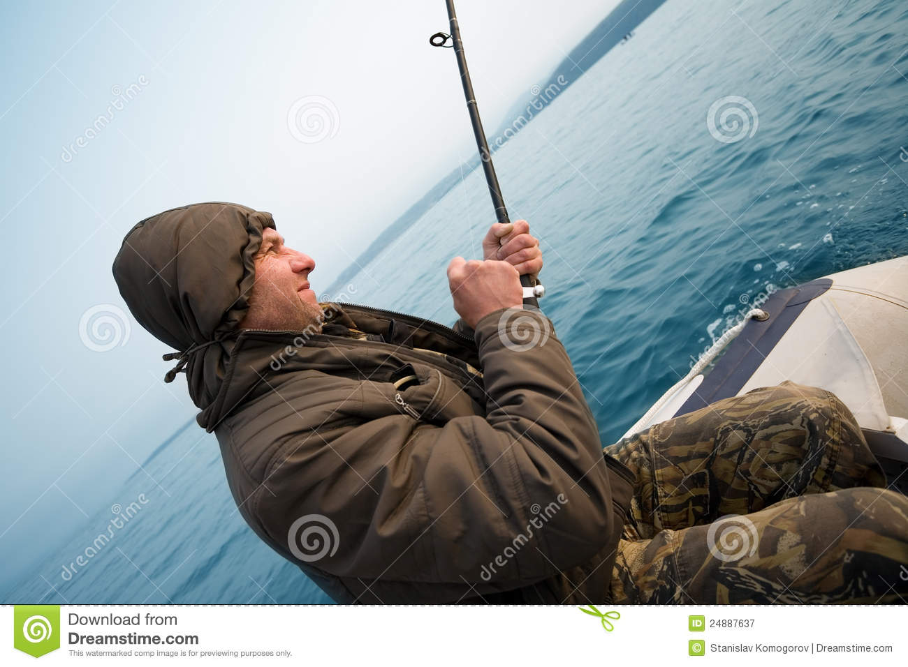 Fisher holds trolling rod stock image  Image of male - 24887637