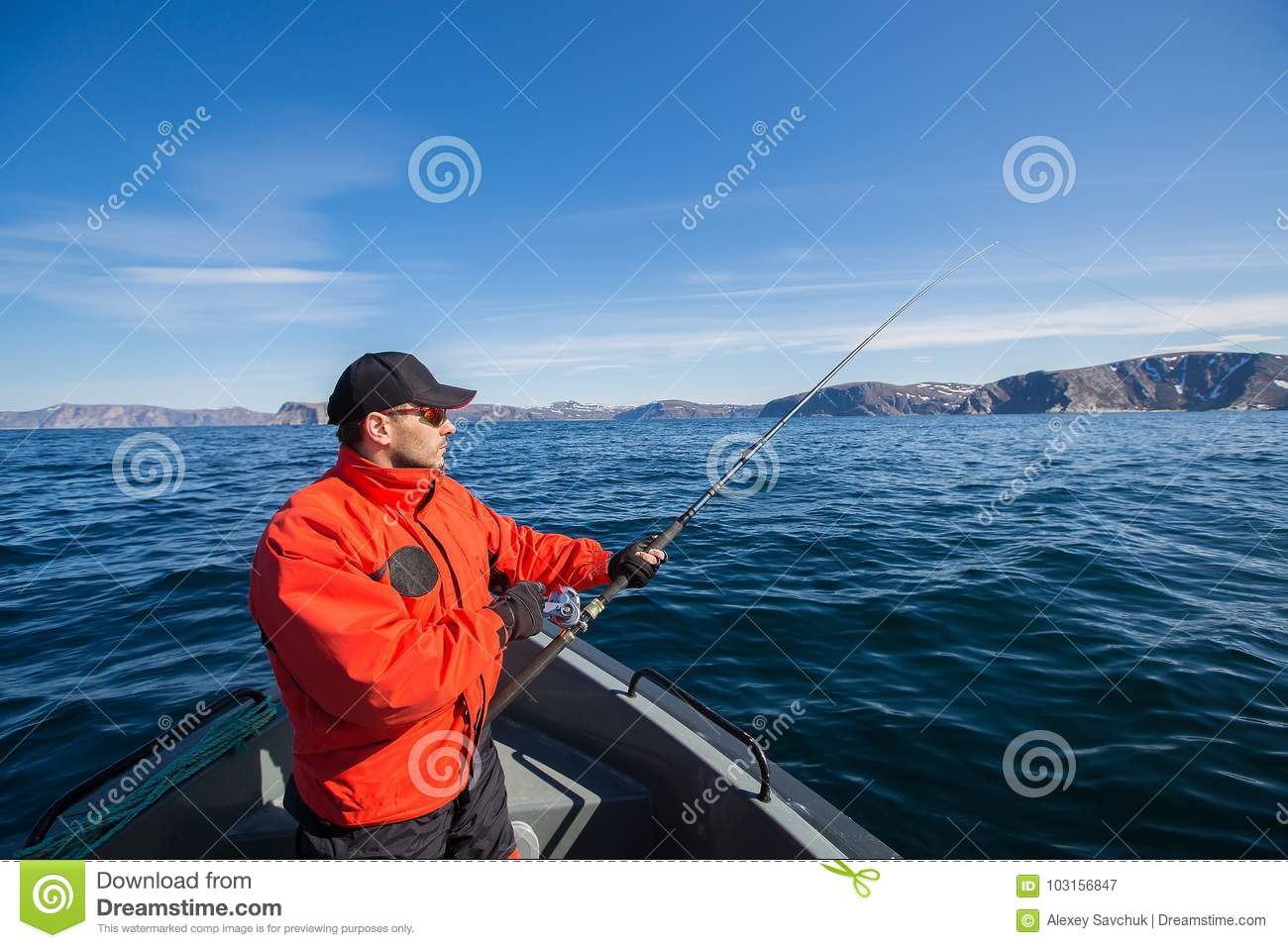 Fisherman athlete with a fishing rod in his hands. a boat. sea.