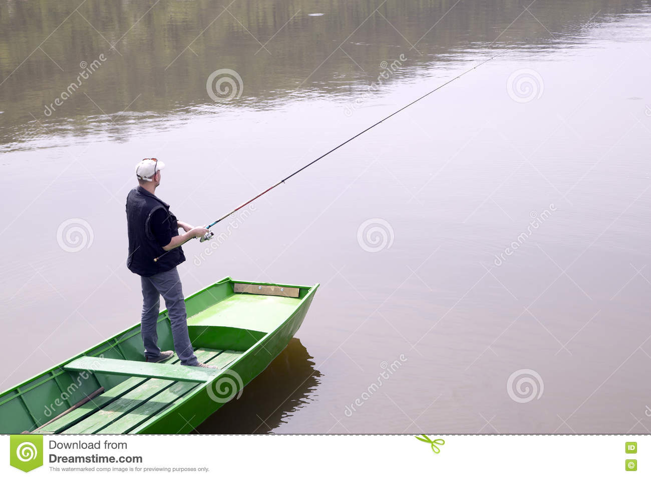 Fisherman Throwing Fishing Rod Stock Image