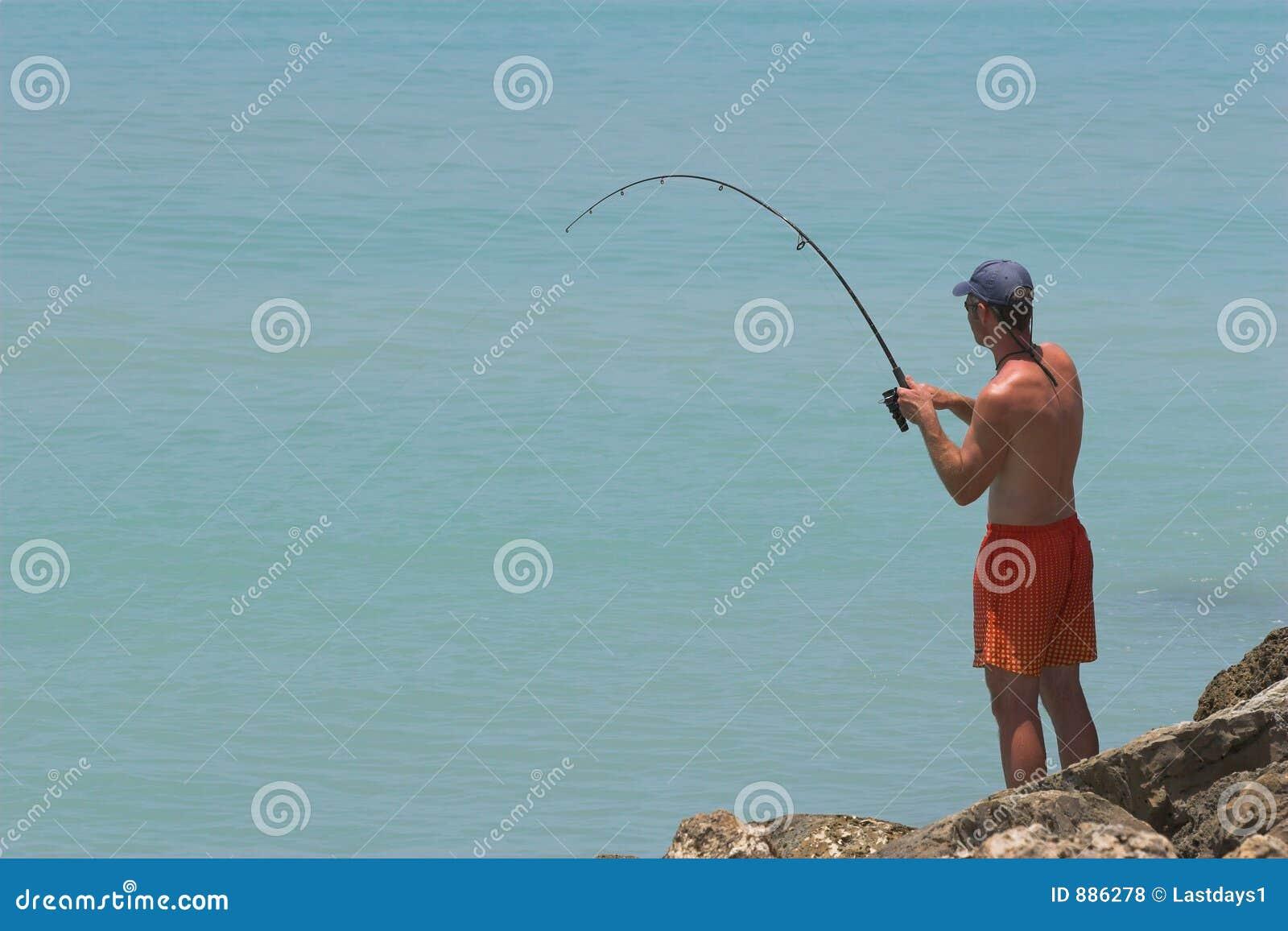 Fisherman Catching Fish Royalty Free Stock Photos