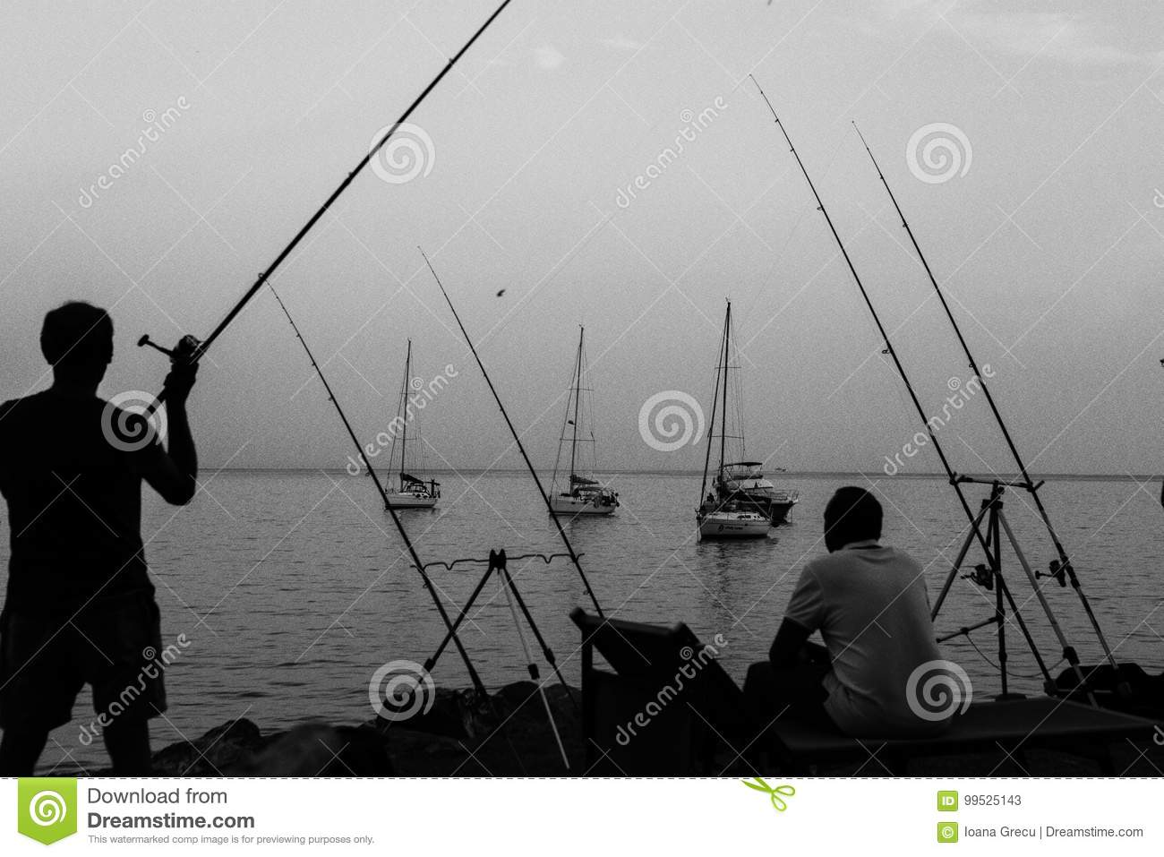 Fisherman catching fish on the coast of Italy
