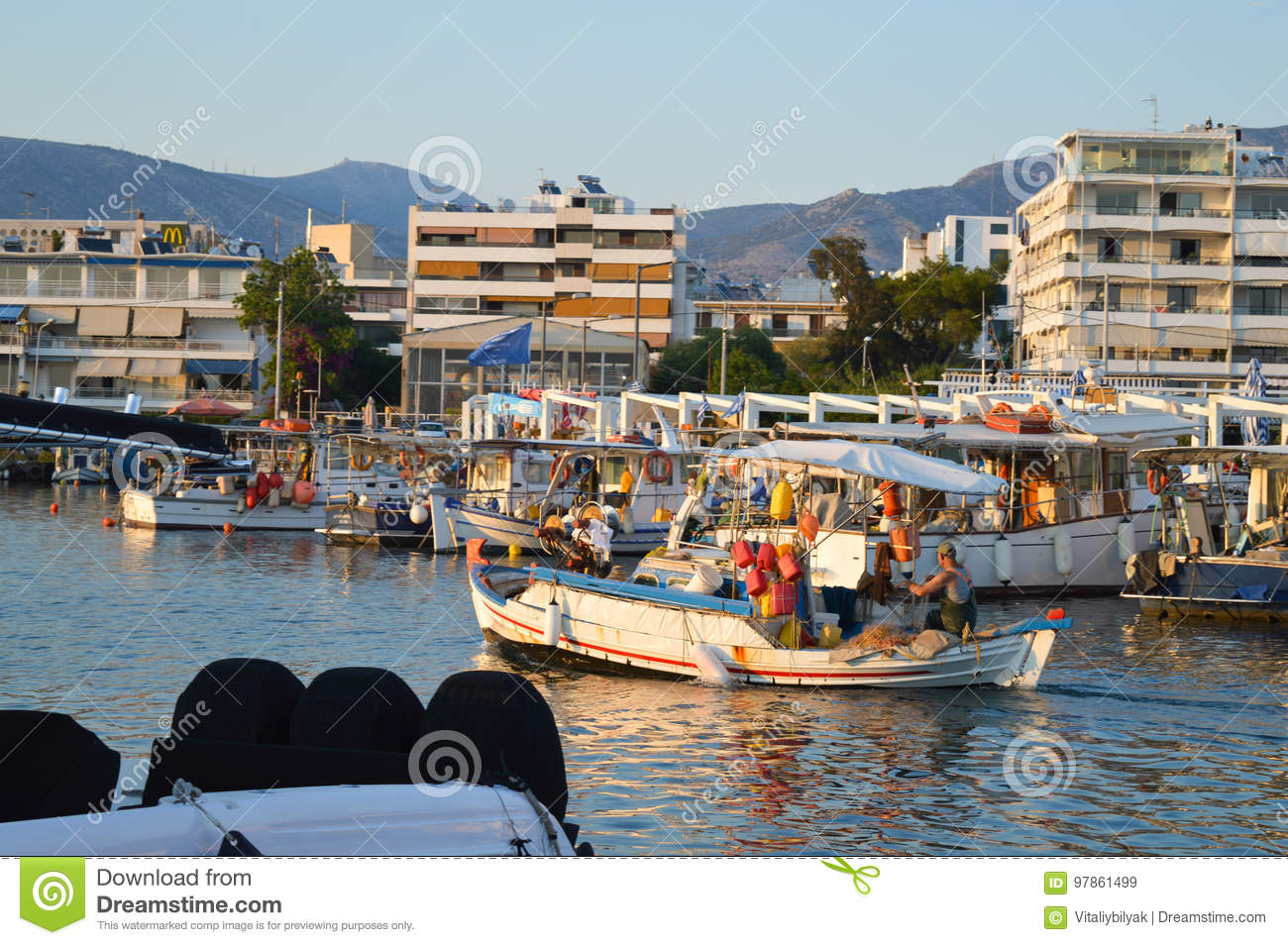 Fisherman coming back in Glyfada, Athens, Greece on June 14, 2017.