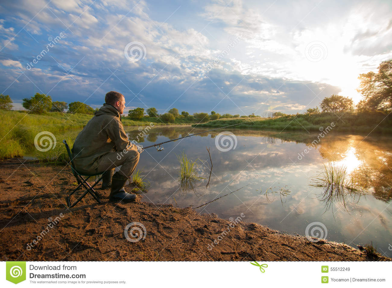 Fisherman with fish rod in his hands near a pond stock for Stocked fishing ponds near me