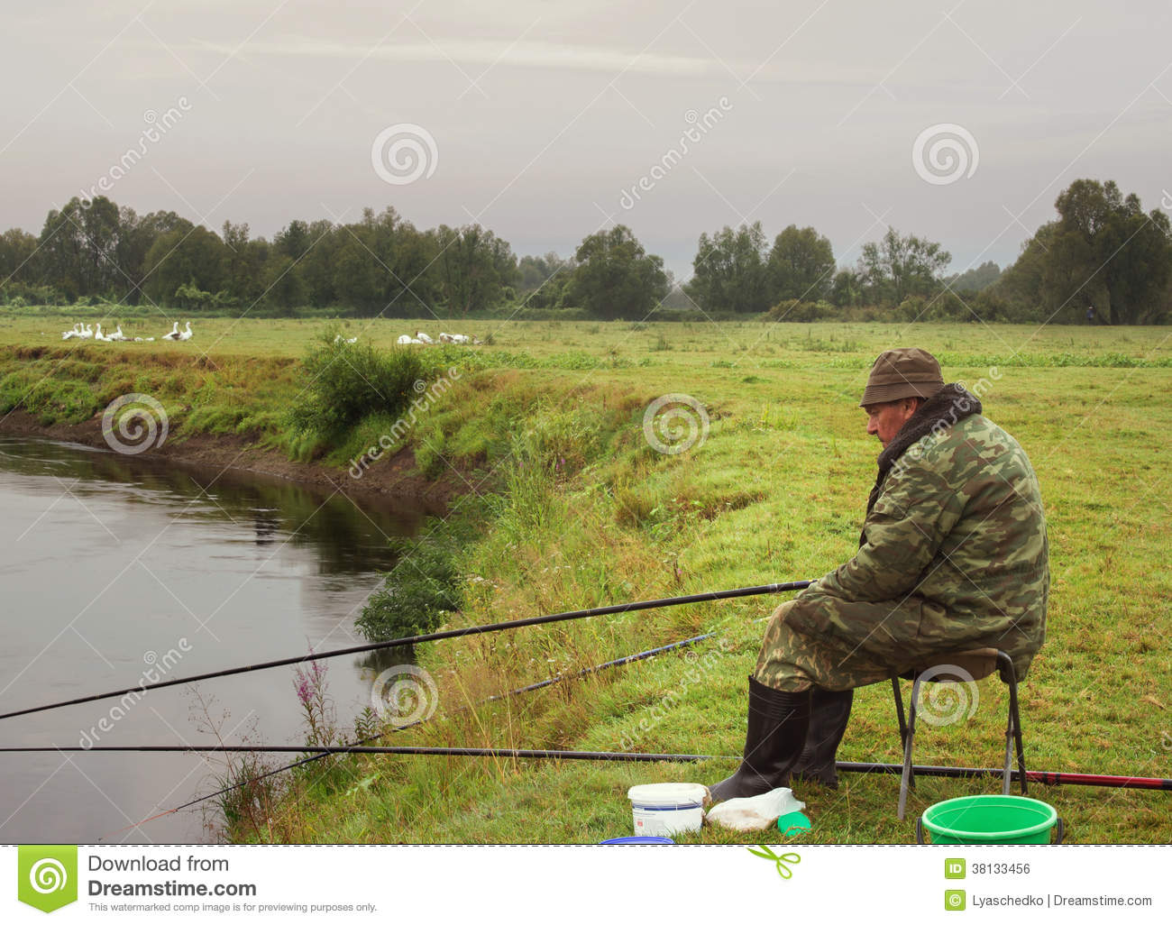 Fisherman fishing on the banks of the river cloudy foggy for River fishing pole
