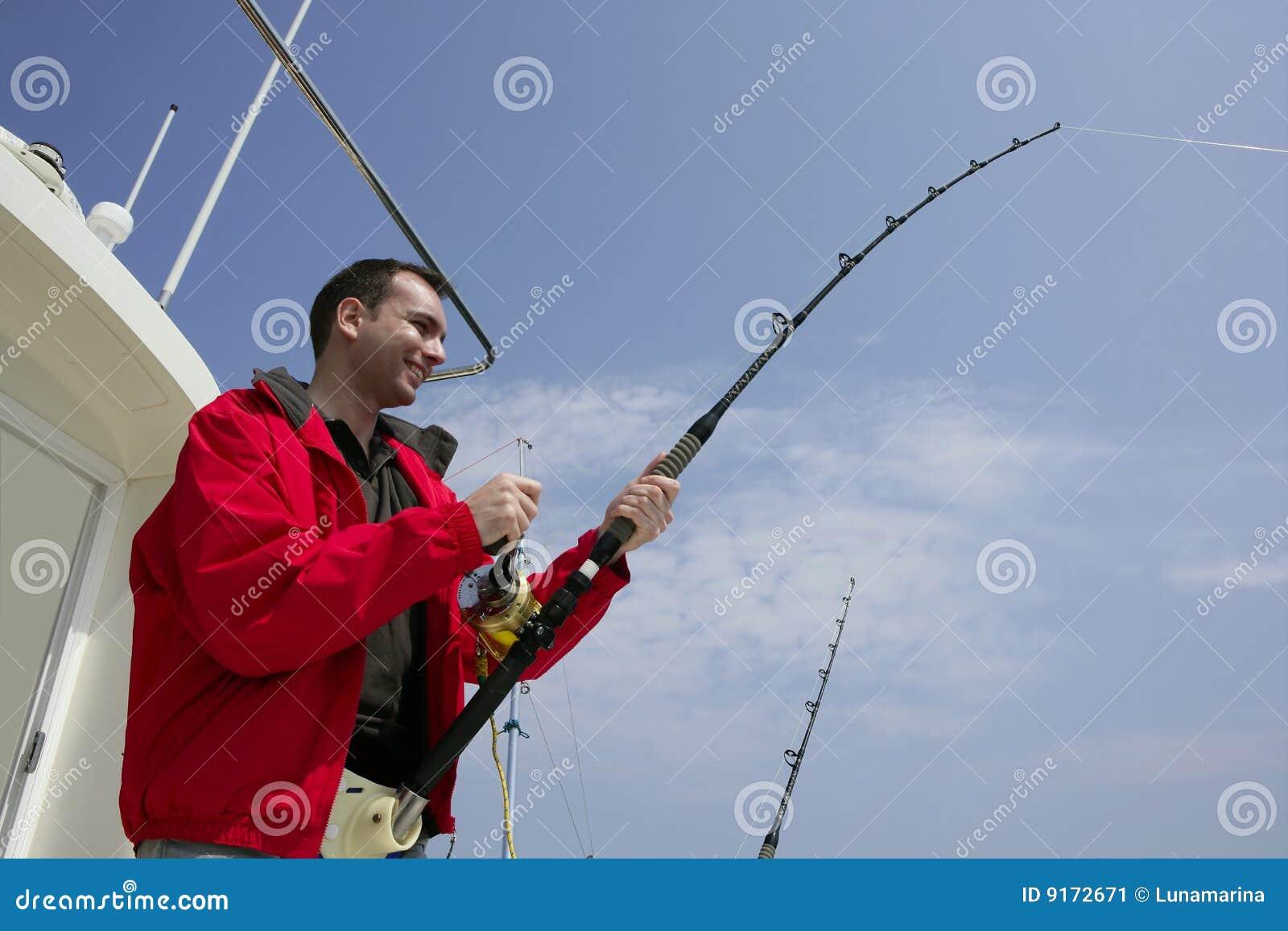 Fisherman fishing on boat big game tuna stock image for Tuna fishing games