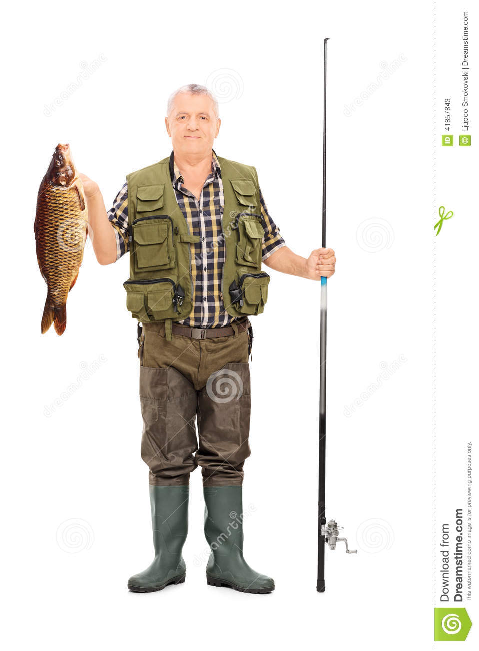 Fisherman holding a fish and a fishing rod stock photo for How many fishing rods per person in texas