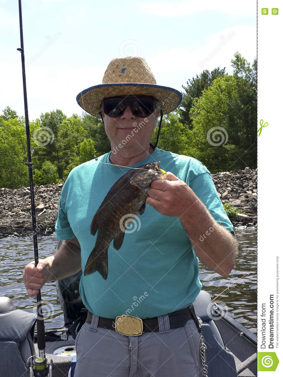 Fisherman portrait with a Small Mouth Bass
