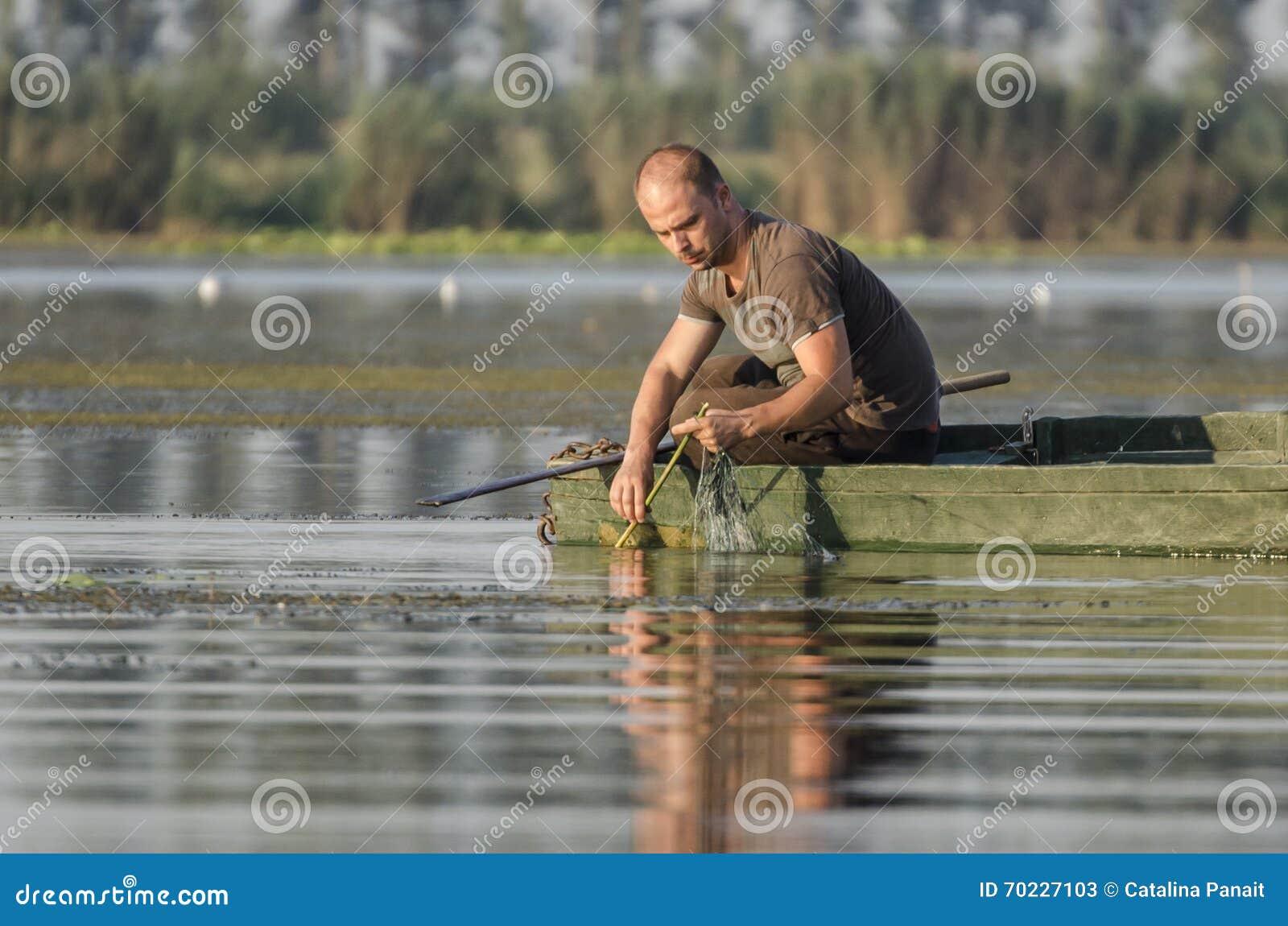 Fisherman pulls net
