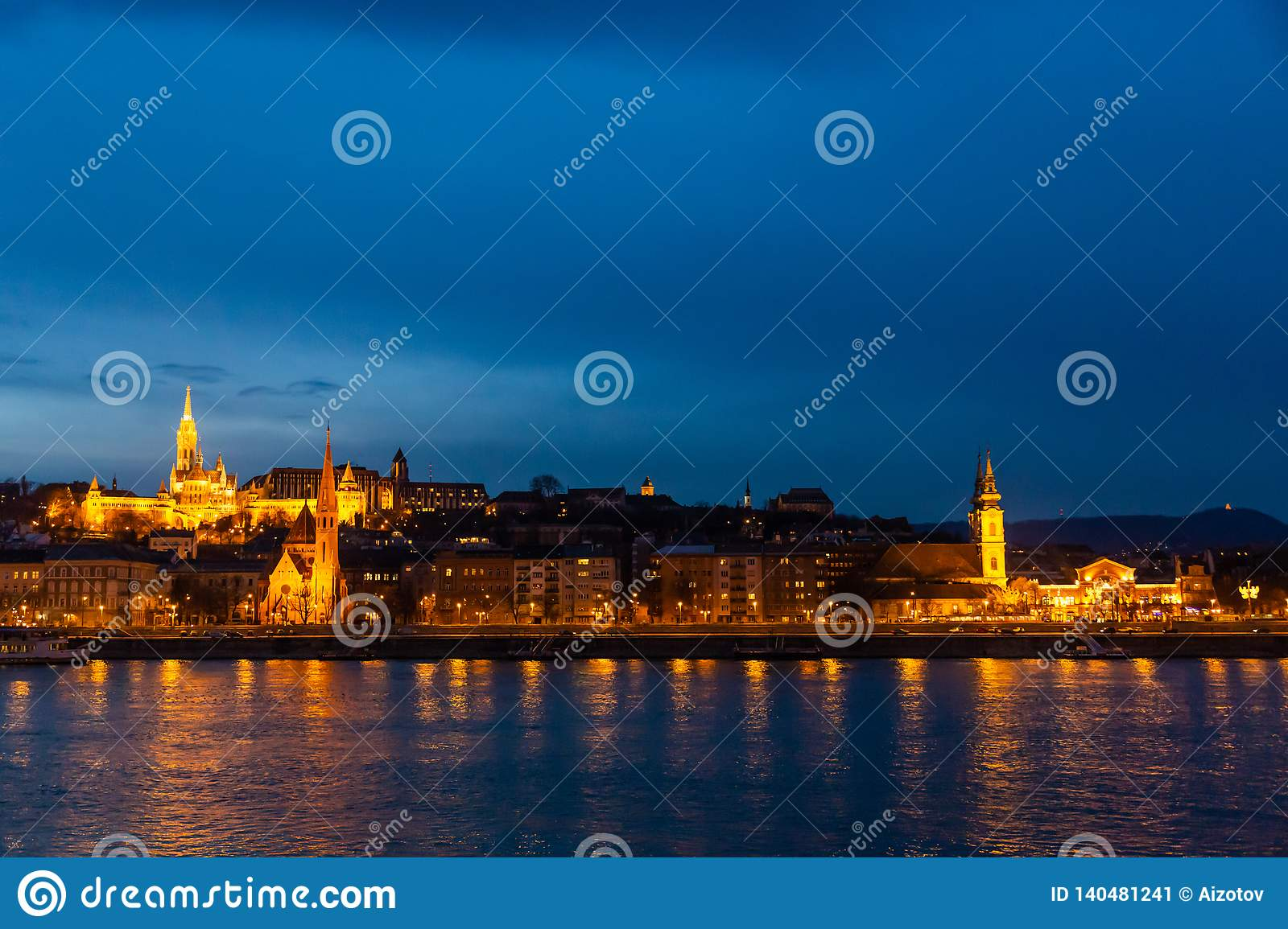 Fisherman`s bastion in night lighting and its reflection in the Danube in Budapest, Hungary