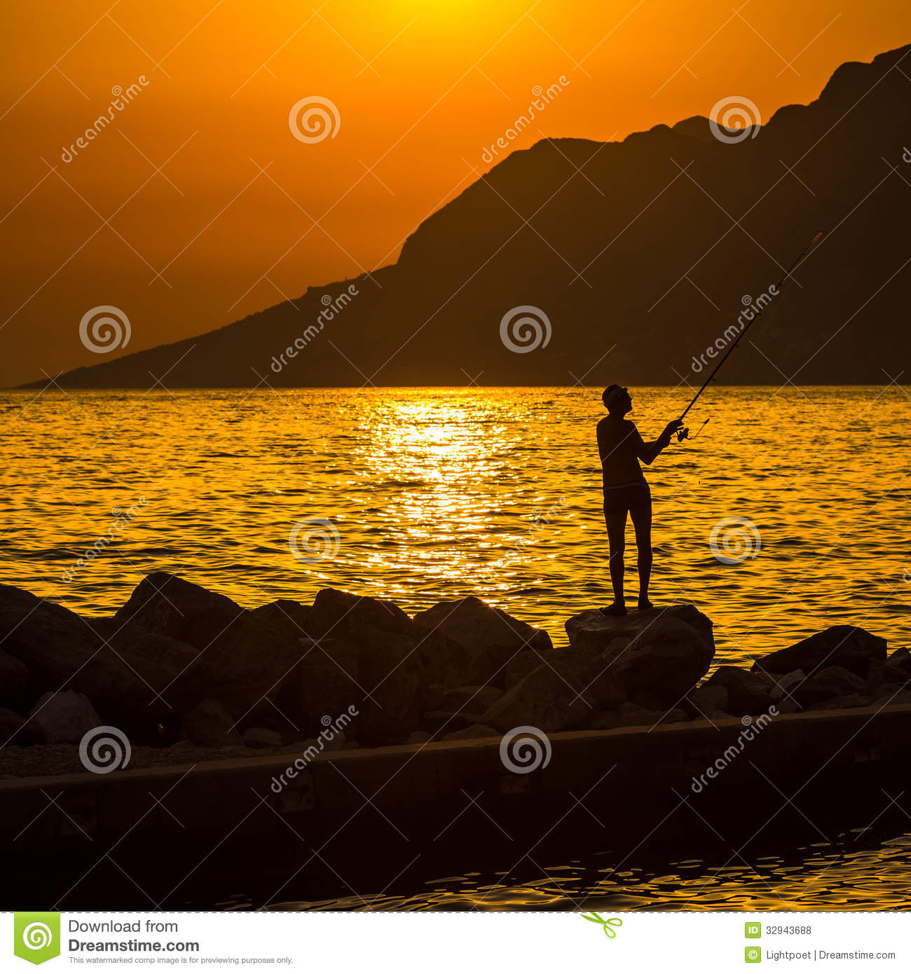 Beach Landscape With Fishermen: Fisherman's Silhouette On The Beach Stock Photo