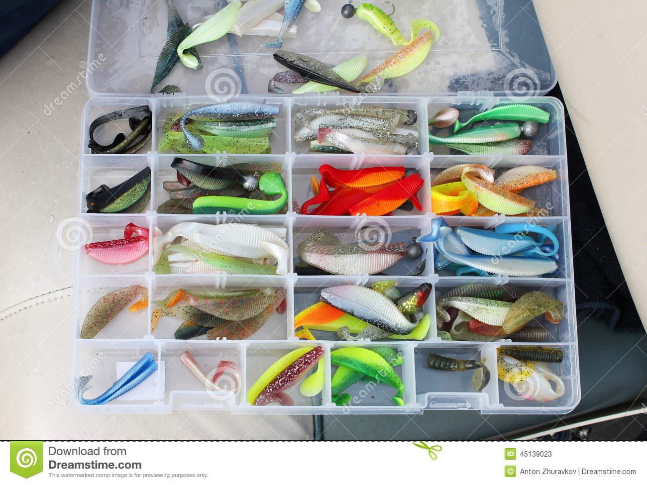 a fisherman's tackle box with lures and gear for fishing stock, Fishing Reels