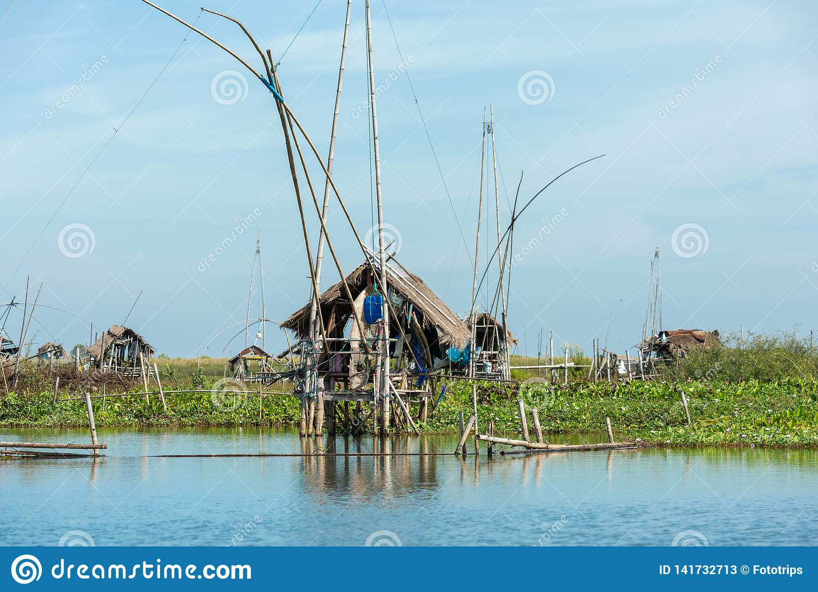 Fisherman`s village in Thailand with a number of fishing tools called `Yok Yor `, Thailand`s traditional fishing tools that made f