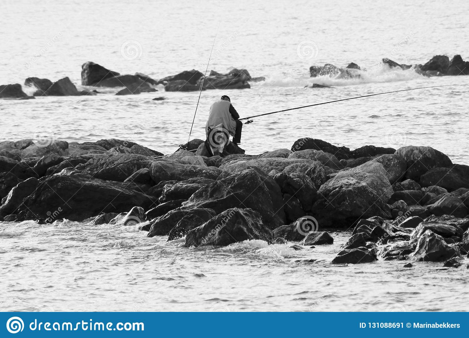 The black and white photo of the fisherman.