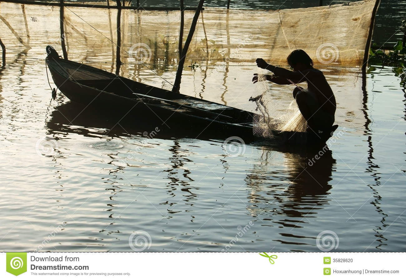 Fisherman Sitting On Row Boat, Pick Up The Net Stock Photo - Image ...