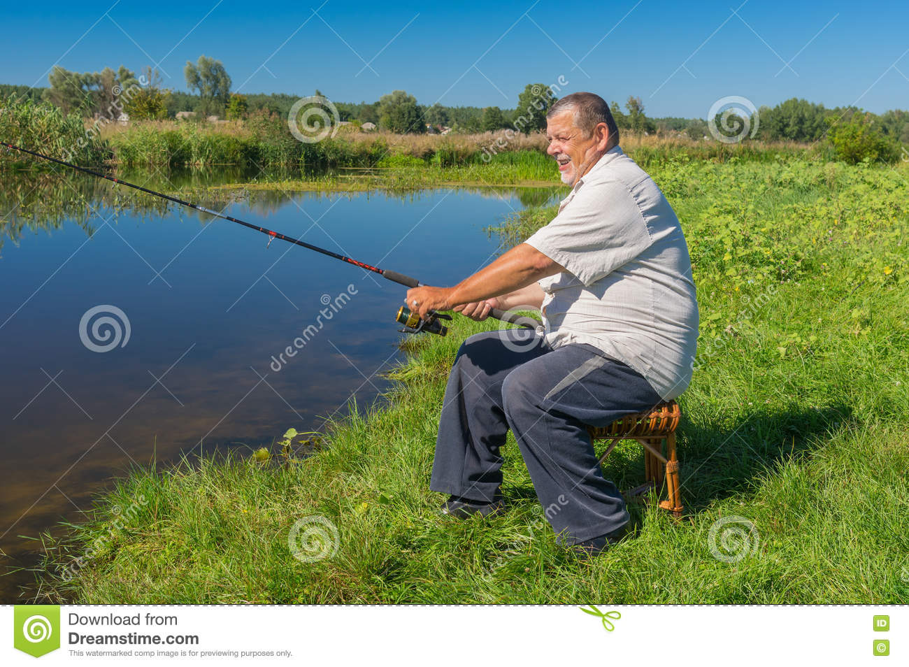 Wondrous Fisherman Sitting On A Wicker Stool With Spinning Rod And Gmtry Best Dining Table And Chair Ideas Images Gmtryco