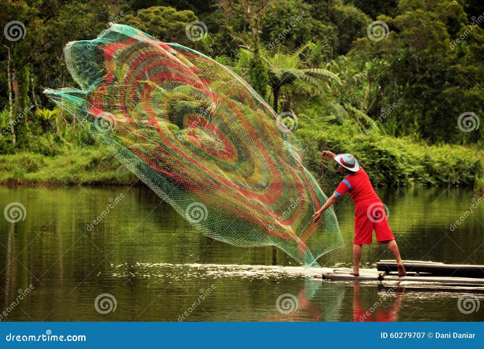 Fisherman Throwing Fishing Net On Situ Gunung Lake Sukabumi West Java Indonesia