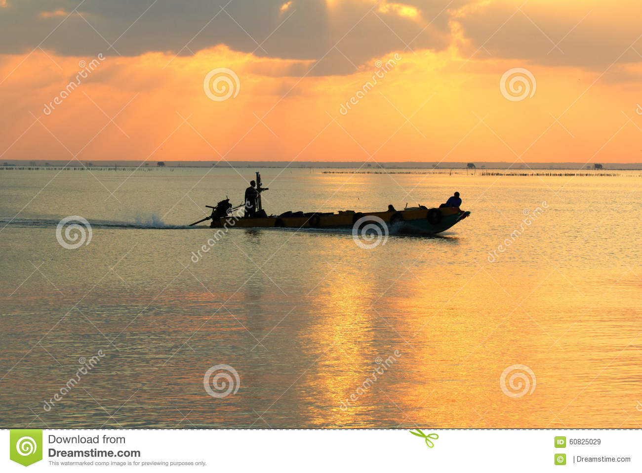 Fishermen on a boat in the morning.