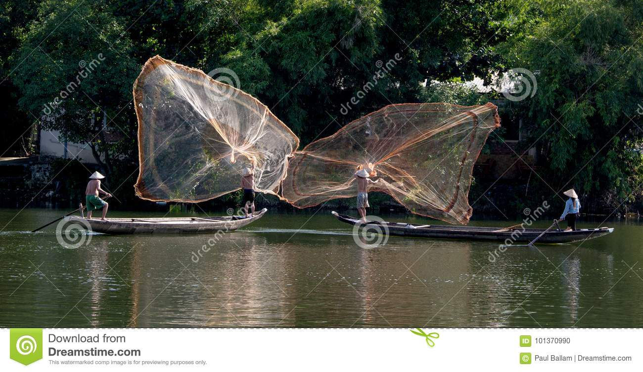 Casting nets from river boats, Hue, Vietnam