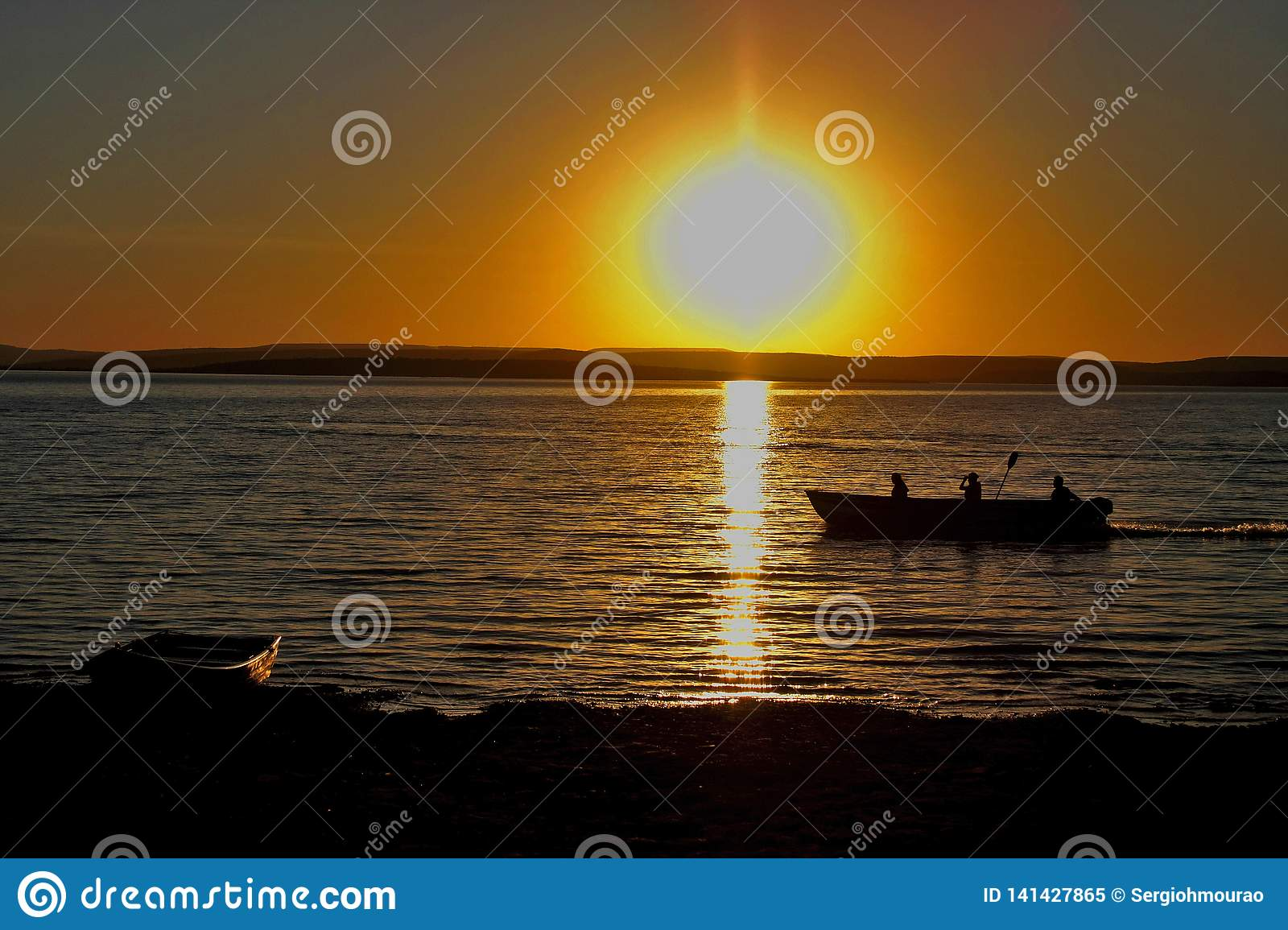 Fishermen at dusk on the São Francisco River