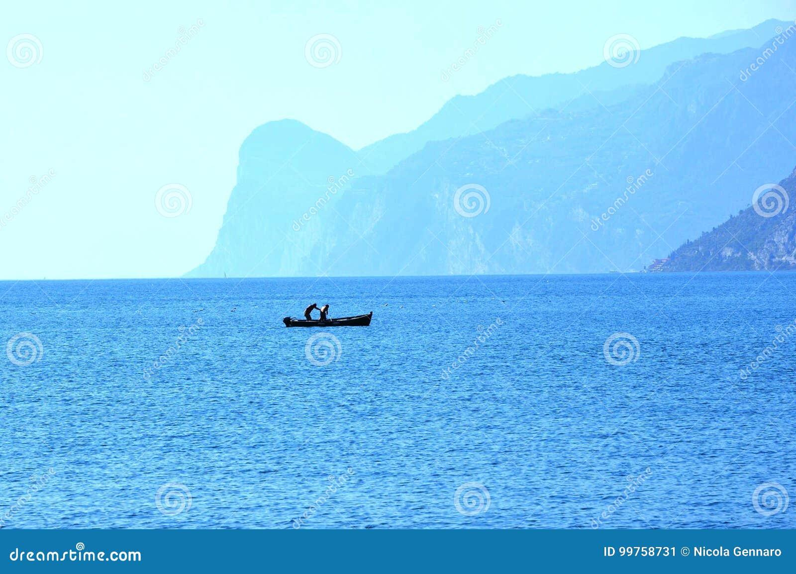 Fishermen on Garda lake in Torbole,